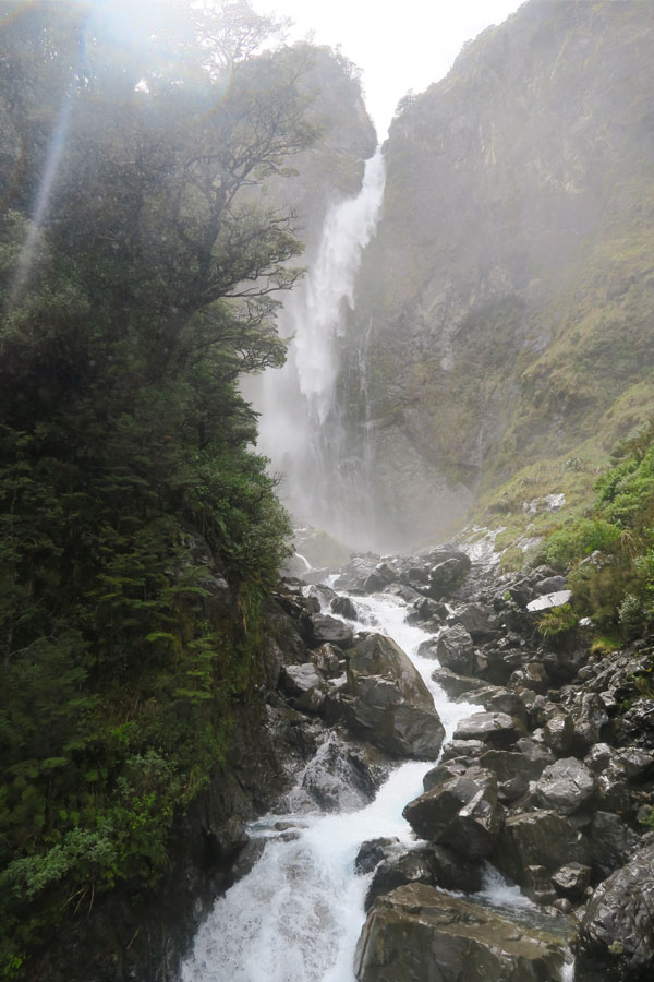 the devil's punchbowl waterfall in Arthur's Pass, New Zealand