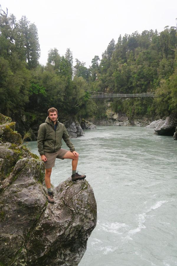 Sam Gill on rock at Hokitika Gorge in Ne Zealand