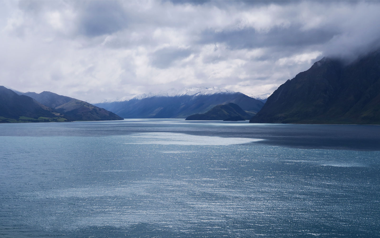 lake hawea with mountains in the background in new zealand