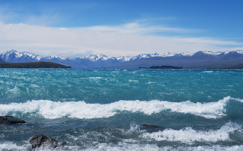 bright blue lake in new zealand called lake tekapo