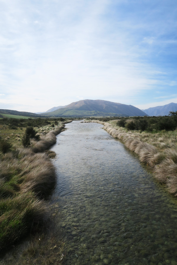 river running towards mountain at mount sunday in new zealand