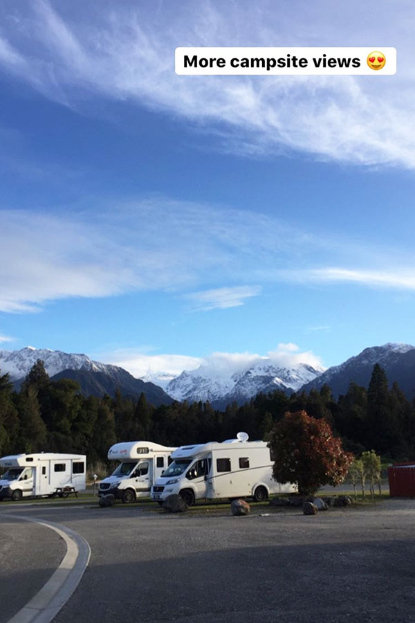 campervans parked in franz josef campsite in new zealand