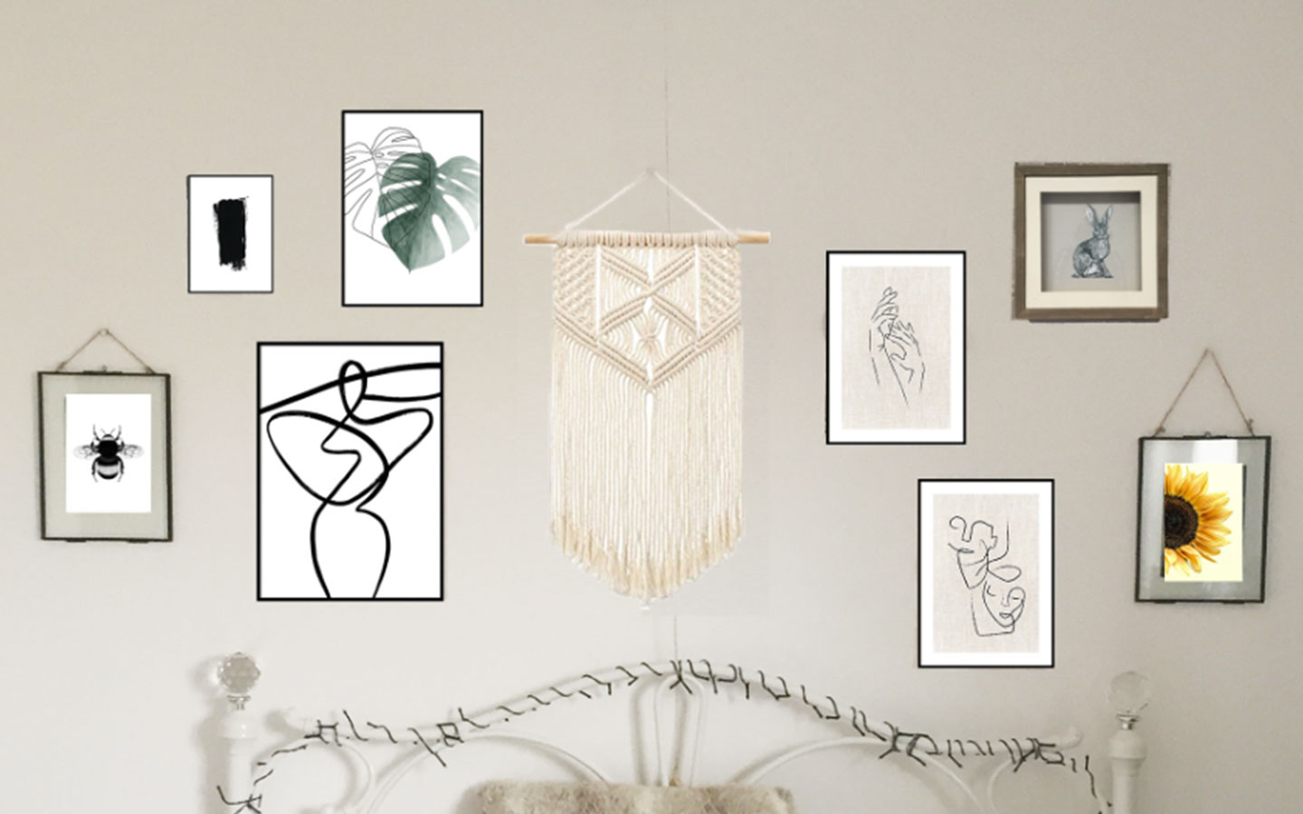 desenio print gallery wall above bed in bedroom
