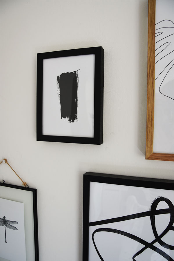 black brish print from desenio on gallery wall