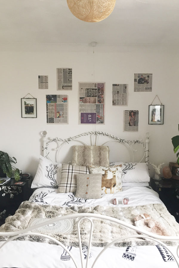 using newspaper to plot out the layout of your gallery wall