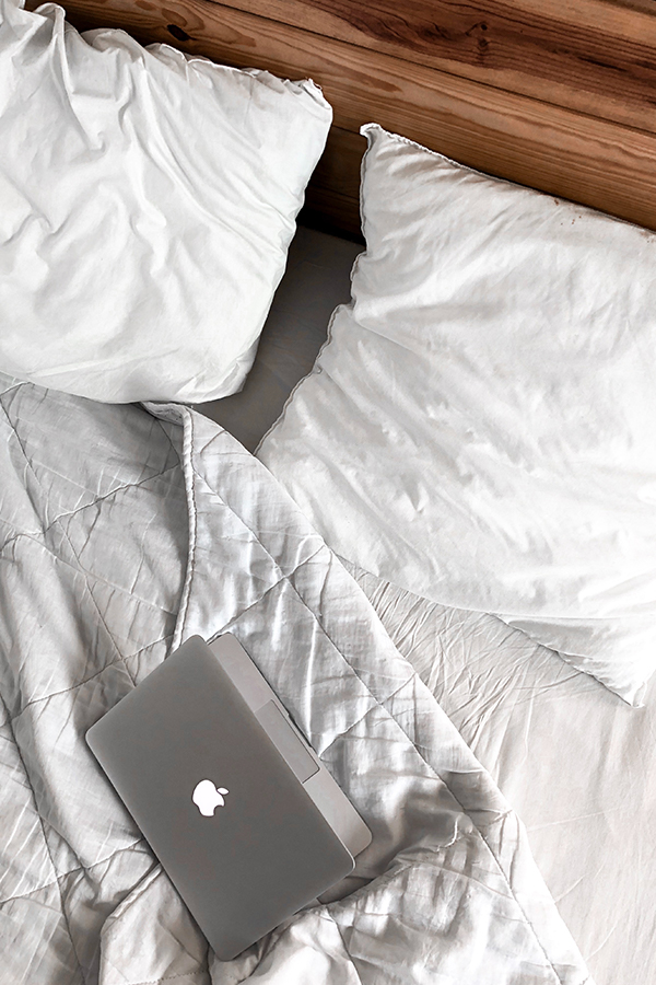 silver macbook on white bedding, graphic design essential