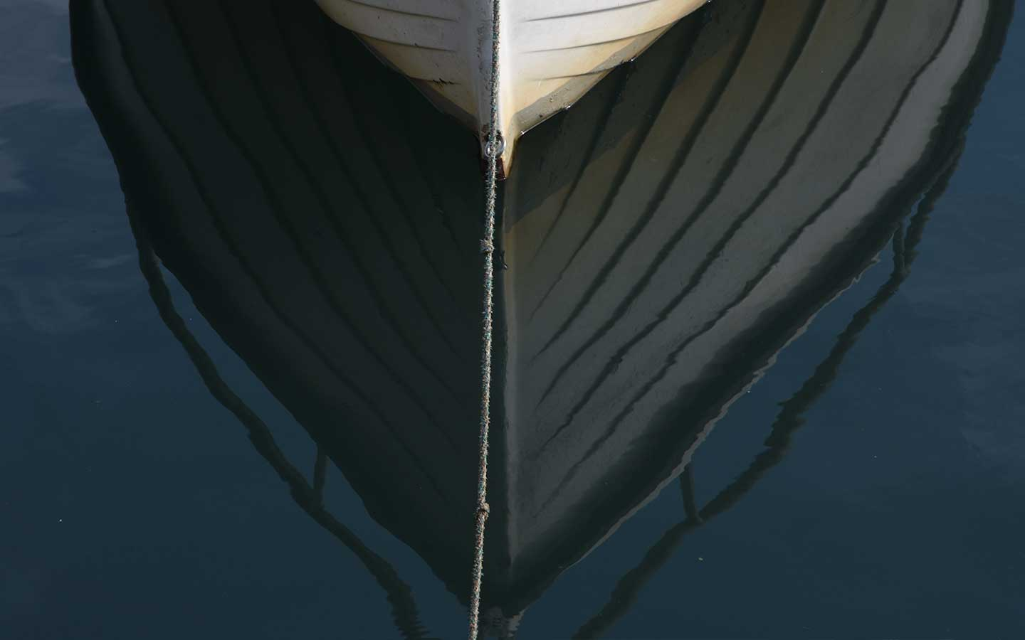 boat reflection in water in cornwall