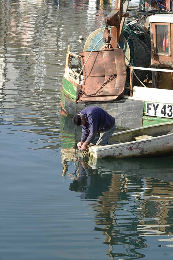 fisherman on fishing boat in mevagissey