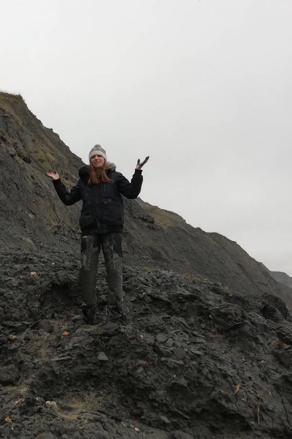 melissa carne in mud while fossil hunting