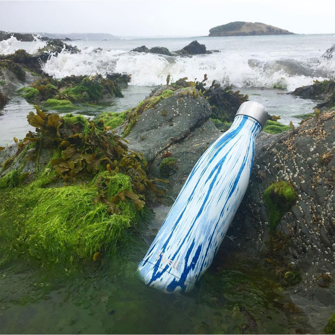 swell reusable bottle in rock pool in cornwall