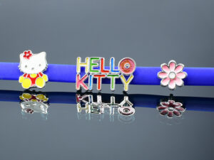 Hello Kitty Baby Bracelet band designed in 92.5 Sterling Silver.It is an article of jewellery that is worn around the wrist. Model SYC 1BTJ001. Comfortable Skin friendly blue Colored Rubber used as band material.Specially designed to attract the kids.A colorful kitty and a flower on two side of the band.It makes kids more attractive without causing any damages to the skin. Both boy and girl kids have used.This sterling silver bracelet is free from micro worms.So it is very safe for kids from causing skin problems. This attractive kids bracelet is flexible in nature and easy to handle. Both boy and girl kids get more attracted to this cartoon model bracelets. It is daily usable product.According to kids hand size hooks provided in bracelet can be adjusted using silver extended rings and be used freely. It be used as a gift product like birthday gift,naming ceremony or a surprise gift for kids. It is light weight and easy to wear product and 925 sterling silver.Specially designed for kids up to 5 years old.SILVERYCRAFT original Silver craft jewellery in India and genuine product.Hello Kitty baby bands doll flowers design SILVERYCRAFT original Silver craft jewellery in India and genuine sterling silver 92.5 jewelry collection silver products silver gifts silver wedding collections female male kids silver sterling 925 silver jewels rare collection silvers Fashion silver fashonable silver crafts Indian made silver e commerce website online silver purchase buy silver jewelleries online SILVERYCRAFT Silver jewellery's Silvery crafts crafted silvers India's fine quality silver at www.silverycraft.com