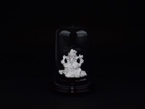 Ganesha God 999 Pure Silver ( using Electroforming Technique ) is a Perfect artifact Collection used for Gift Purpose or Spiritual purpose, Show Piece , Home Decorative or can be used in Car Dashboards. It is crafted with 99.9% pure silver and inside silver idol is lightweight. Silver idol is covered with transparent cubic bottle to avoid damages and to prevent entry of atmosphere air which can easily change color of Pure Silver. Pure Silver Metals easily combine with Natural oxygen and forms Silver oxide due to the very reactive property of 999 Pure silver. Our Protective case also prevent the formation of Silver oxide and maintain the Perfect Glossiness of 999 Silver. In case if you remove casing then a small black layer formation may appear in Idol due to entry of Oxygen and it does not mean any problem in your Idol and it also indicate or Prove the Quality of our Silver. Even though we suggest not to remove the casing or don't allow the direct exposure to air without the casing.Oxidized silver have it's own beauty and it's your choice to keep it oxidized or not. 999 Silver is no doubt a very unique gifting solution and perfect for any purpose