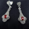 925 Sterling silver  Earring with white and red stone for womens and girls Model no SYC 2ERH39.This material is made of 925 sterling silver with a white glazing stone.Suitable for Females in Wedding functions,office use,daily wear,birthday,marriage, engagement and any other occasions.Unique Piece comes with Traditional Style suitable for all occasions. 92.5 Sterling silver is relatively soft in nature and remaining 7.5 alloy especially copper  increase hardness and strength and it reduces tarnishing.This sterling silver even use for sensitive skins.This may not cause any skin problems.You can clean this ring by dip in a hot water with 2 tablespoon of salt and baking soda. After the tarnish disappears, rinse your silver jewellery with water and dry it using a soft cloth.A red stone on earring increases more beauty. 925 Sterling silver gives more beauty and elegant look to those who wear it.  Instead of using fancy earrings use silver sterling earrings is more comfortable, skin friendly and get elegant look. It is affordable for  luxury jewellery made of sterling silver. Sterling silver even suits for black tone skins. The word sterling silver is associated with superior quality since 1266. Silver jewellery are mainly seen on tombs of king and queen that giving us an idea of valuable. Sterling silver earring enhances the beauty and give a pretty look. It is easy to care and no maintenance issue occur. It is light weight so easy to handle without causing any damages to skin. For more care of silver keep away from perfumes and other chemicals.
