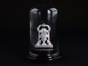 Tirupati Lord Venkateswara Idol 999 Pure Silver using Electroforming Technique is a Perfect artifact Collection used for Gift Purpose or Spiritual purpose, Show Piece , Home Decorative or can be used in Car Dashboards. It is crafted with 99.9% pure silver and inside silver idol is lightweight. Silver idol is covered with transparent cubic bottle to avoid damages and to prevent entry of atmosphere air which can easily change color of Pure Silver. Pure Silver Metals easily combine with Natural oxygen and forms Silver oxide due to the very reactive property of 999 Pure silver. Our Protective case also prevent the formation of Silver oxide and maintain the Perfect Glossiness of 999 Silver. In case if you remove casing then a small black layer formation may appear in Idol due to entry of Oxygen and it does not mean any problem in your Idol and it also indicate or Prove the Quality of our Silver. Even though we suggest not to remove the casing or don't allow the direct exposure to air without the casing.Oxidized silver have it's own beauty and it's your choice to keep it oxidized or not. 999 Silver is no doubt a very unique gifting solution and perfect for any purpose. Tirupati Lord Venkateswara Venkateswara literally means lord of venkata,venkateswara is the Hindu god of wealth, good fortune, prosperity and beauty. Venkateswara an incarnation of Vishnu, who is believed to have appeared here to save life and troubles of Kali Yuga. Venkateswara Idol supposed to bring you with abundant prosperity, wealth, health and a very good luck.Lord Venkateswara also known as Srinivasa Venkateswara SILVERYCRAFT original Silver craft jewellery in India and genuine sterling silver 999 jewelry collection silver products silver gifts silver wedding collections silver sterling 999 silver jewels rare collection silvers silver crafts Indian made silver e commerce website online silver purchase buy silver jewelleries online SILVERYCRAFT Silver jewellery's Silvery crafts crafted silvers India's fine quality silver at www.silverycraft.com