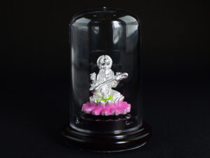 Goddess Saraswati devi Silver Idol 999 Pure Silver using Electroforming Technique is a Perfect artifact Collection used for Gift Purpose or Spiritual purpose, Show Piece , Home Decorative or can be used in Car Dashboards. It is crafted with 99.9% pure silver and inside silver idol is lightweight. Silver idol is covered with transparent cubic bottle to avoid damages and to prevent entry of atmosphere air which can easily change color of Pure Silver. Pure Silver Metals easily combine with Natural oxygen and forms Silver oxide due to the very reactive property of 999 Pure silver. Our Protective case also prevent the formation of Silver oxide and maintain the Perfect Glossiness of 999 Silver. In case if you remove casing then a small black layer formation may appear in Idol due to entry of Oxygen and it does not mean any problem in your Idol and it also indicate or Prove the Quality of our Silver. Even though we suggest not to remove the casing or don't allow the direct exposure to air without the casing.Oxidized silver have it's own beauty and it's your choice to keep it oxidized or not. 999 Silver is no doubt a very unique gifting solution and perfect for any purpose.Caring Solution : Handle gently, blot with cloths or tissue paper after applying mild shampoo if necessary for cleaning purpose, Don't apply milk, water, curd or don't use flowers or Garland for a prolonged time. Enrich your pooja rooms always or gift the divine beauty or Make your car dash board enriched with Positive energy. Goddess Saraswati devi is the Hindu goddess of knowledge, music, art, wisdom, and leanings . Saraswati devi is believed to bless people who take up intellectual pursuits and student's pray to her before examinations. The idol theme is saraswathi devi sitting in a lotus with musical instrument veena. SILVERYCRAFT original Silver craft jewellery in India and genuin