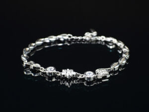 Ladies 925silver chainbracelet of code SYC 2BTF18.It is an article of jewellery that is worn around the wrist.Genuine silver product with high quality crystal stones.This bracelet is skin friendly in nature.It looks most attractive and look.It can be worn at any occasion like wedding ceremony, party,and present as a gift for valentines, anniversaries and gave as a special gift for our loved ones.It is most stylish and modern in look.When you wear this it adds as a stylish look to you.This product and gives elegant look..To increase the life of this product after use keep the product in a box or soft cloth pouch and keep away from chemicals and perfumes.Sterling silver is relatively soft in nature so copper is added as an alloy to increase hardness and strength and it reduces tarnishing. In sterling silver 92.5% is silver it is marked as 925. It is daily usable.It absorbs the body heat and keep our body cool for a long time.SILVERYCRAFT original Silver craft jewellery in India and genuine sterling silver 92.5 jewelry collection silver products silver gifts silver wedding collections female male kids silver sterling 925 silver jewels rare collection silvers Fashion silver fashonable silver crafts Indian made silver e commerce website online silver purchase buy silver jewelleries online SILVERYCRAFT Silver jewellery's Silvery crafts crafted silvers India's fine quality silver at www.silverycraft.com