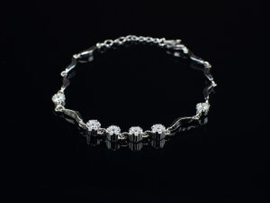 Ladies 925silver chainbracelet of code SYC 2BTF17.It is an article of jewellery that is worn around the wrist.Genuine silver product with high quality crystal stones.This bracelet is skin friendly in nature.It looks most attractive and look.It can be worn at any occasion like wedding ceremony, party,and present as a gift for valentines, anniversaries and gave as a special gift for our loved ones.It is most stylish and modern in look.When you wear this it adds as a stylish look to you.This product and gives elegant look..To increase the life of this product after use keep the product in a box or soft cloth pouch and keep away from chemicals and perfumes.Sterling silver is relatively soft in nature so copper is added as an alloy to increase hardness and strength and it reduces tarnishing. In sterling silver 92.5% is silver it is marked as 925. It is daily usable.It absorbs the body heat and keep our body cool for a long time.SILVERYCRAFT original Silver craft jewellery in India and genuine sterling silver 92.5 jewelry collection silver products silver gifts silver wedding collections female male kids silver sterling 925 silver jewels rare collection silvers Fashion silver fashonable silver crafts Indian made silver e commerce website online silver purchase buy silver jewelleries online SILVERYCRAFT Silver jewellery's Silvery crafts crafted silvers India's fine quality silver at www.silverycraft.com