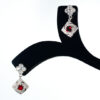 925 Sterling silver Earring hanging with marcasite and red stone for womens and girls Model no SYC 2ERS46.This material is made of 925 sterling silver with a white and oval shaped red glazing stones.Suitable for Females in Wedding functions,office use,daily wear,birthday,marriage, engagement and any other occasions.Unique Piece comes with Traditional Style suitable for all occasions. 92.5 Sterling silver is relatively soft in nature and remaining 7.5 alloy especially copper increase hardness and strength and it reduces tarnishing.This sterling silver even use for sensitive skins.This may not cause any skin problems.You can clean this ring by using soft banyan cloth. After the tarnish disappears, rinse your silver jewellery with water and dry it using a soft cloth.A red stone on earring increases more beauty with more attraction. 925 Sterling silver gives more beauty and elegant look to those who wear it. Instead of using fancy earrings use silver sterling earrings is more comfortable, skin friendly and get elegant look. It is affordable for luxury jewellery made of sterling silver. Sterling silver even suits for black tone skins. The word sterling silver is associated with superior quality since 1266. Silver jewellery are mainly seen on tombs of king and queen that giving us an idea of valuable. Sterling silver earring enhances the beauty and give a pretty look. It is easy to care and no maintenance issue occur. It is light weight so easy to handle without causing any damages to skin. For more care of silver keep away from perfumes and other chemicals.SILVERYCRAFT original Silver craft jewellery in India and genuine sterling silver 92.5 jewelry collection silver products silver gifts silver wedding collections female male kids silver sterling 925 silver jewels rare collection silvers Fashion silver fashonable silver crafts Indian made silver e commerce website online silver purchase buy silver jewelleries online SILVERYCRAFT Silver jewellery's Silvery crafts crafted