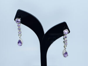 925 Sterling silver Earring with semi precious purple stone for womens and girls Model no SYC 2ERH92.This material is made of 925 sterling silver with a white glazing stone.Suitable for Females in Wedding functions,office use,daily wear,birthday,marriage, engagement and any other occasions.Unique Piece comes with Traditional Style suitable for all occasions. 92.5 pure silver is relatively soft in nature.So 92.5% pure silver and remaining 7.5 alloy especially copper added to sterling silver that increase hardness and strength and it reduces tarnishing.This sterling silver even use for sensitive skins.This may not cause any skin problems.You can clean this ring by using soft banyan cloth. After the tarnish disappears, rinse your silver jewellery with water and dry it using a soft cloth.. 925 Sterling silver gives more beauty and elegant look to those who wear it. Instead of using fancy earrings use silver sterling earrings is more comfortable, skin friendly and get elegant look. It is affordable for luxury jewellery made of sterling silver. Sterling silver even suits for black tone skins. The word sterling silver is associated with superior quality since 1266. Silver jewellery are mainly seen on tombs of king and queen that giving us an idea of valuable. Sterling silver earring enhances the beauty and give a pretty antique look. It is easy to care and no maintenance issue occur. . For more care of silver keep away from perfumes and other chemicals.SILVERYCRAFT original Silver craft jewellery in India and genuine sterling silver 92.5 jewelry collection silver products silver gifts silver wedding collections female male kids silver sterling 925 silver jewels rare collection silvers Fashion silver fashonable silver crafts Indian made silver e commerce website online silver purchase buy silver jewelleries online SILVERYCRAFT Silver jewellery's Silvery crafts crafted silvers India's fine quality silver at www.silverycraft.com