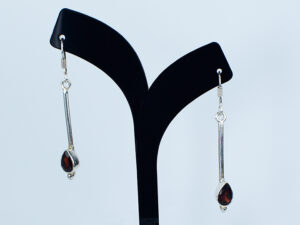 925 Sterling silver  Earring with semi precious ruby stone for womens and girls Model no SYC 2ERH78. This product is made of 925 sterling silver long hanging with semi precious ruby stone.Suitable for Females in Wedding functions,office use,daily wear,birthday,marriage, engagement and any other occasions.Unique Piece comes with modern Style suitable for all occasions. 92.5 pure silver is relatively soft in nature.So 92.5% pure silver and remaining 7.5 alloy especially copper added to sterling silver that increase hardness and strength and it reduces tarnishing.This sterling silver even use for sensitive skins.This may not cause any skin problems.You can clean this earring by using soft banyan cloth. After the tarnish disappears, rinse your silver jewellery with water and dry it using a soft cloth.. 925 Sterling silver gives more beauty and elegant look to those who wear it.  Instead of using fancy earrings use silver sterling earrings is more comfortable, skin friendly and get elegant look. It is affordable for  luxury jewellery made of sterling silver. Sterling silver even suits for black tone skins. The word sterling silver is associated with superior quality since 1266. Silver jewellery are mainly seen on tombs of king and queen that giving us an idea of valuable. Sterling silver earrings enhances the beauty and give a pretty modern look. It is easy to care and no maintenance issue occur. . For more care of silver keep away from perfumes and other chemicals.SILVERYCRAFT original Silver craft jewellery in India and genuine sterling silver 92.5 jewelry collection silver products silver gifts silver wedding collections female male kids silver sterling 925 silver jewels rare collection silvers Fashion silver fashonable silver crafts Indian made silver e commerce website online silver purchase buy silver jewelleries online SILVERYCRAFT Silver jewellery's Silvery crafts crafted silvers India's fine quality silver at www.silverycraft.com