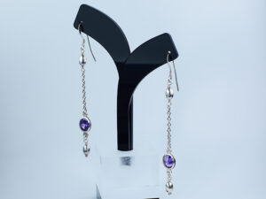 925 Sterling silver Earring with semi precious purple gemstone for womens and girls Model no SYC 2ERH95. This product is made of 925 sterling silver long chain hanging with semi precious purple gemstone.Suitable for Females in Wedding functions,office use,daily wear,birthday,marriage, engagement and any other occasions.Unique Piece comes with modern Style suitable for all occasions. 92.5 pure silver is relatively soft in nature.So 92.5% pure silver and remaining 7.5 alloy especially copper added to sterling silver that increase hardness and strength and it reduces tarnishing.This sterling silver even use for sensitive skins.This may not cause any skin problems.You can clean this earring by using soft banyan cloth. After the tarnish disappears, rinse your silver jewellery with water and dry it using a soft cloth.. 925 Sterling silver gives more beauty and elegant look to those who wear it. Instead of using fancy earrings use silver sterling earrings gives more comfortable, skin friendly and get elegant look. It is affordable for luxury jewellery made of sterling silver. Sterling silver even suits for black tone skins. The word sterling silver is associated with superior quality since 1266. Silver jewellery are mainly seen on tombs of king and queen that giving us an idea of valuable. Sterling silver earrings enhances the beauty and give a pretty modern look. It is easy to care and no maintenance issue occur.For more care of silver keep away from perfumes and other chemicals.SILVERYCRAFT original Silver craft jewellery in India and genuine sterling silver 92.5 jewelry collection silver products silver gifts silver wedding collections female male kids silver sterling 925 silver jewels rare collection silvers Fashion silver fashonable silver crafts Indian made silver e commerce website online silver purchase buy silver jewelleries online SILVERYCRAFT Silver jewellery's Silvery crafts crafted silvers India's fine quality silver at www.silverycraft.com