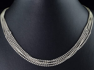 "925 Sterling Silver Beautiful Layer Necklace For Womens And Girls Model SYC 2N74. This is ideal  for womens and girls. Unique piece comes on contemporay style perfect for all outfits. Suitable for daily use,office use and perfect gift for our loved ones.  Importance of 925 Sterling Silver : We are aware of the trending style and beauty of Sterling silver but the Most Important Part of Sterling Silver 925 is the health benefits. Silver ions in Silver material has a proven record of antibiotic nature. The excellent way to obtain health improvement from 925 Sterling silver is when it get in touch with the skin. Silver is antibacterial too and helps to improve blood circulation and help remove toxins present in the human body. Some studies even mention about the defensive power of Silver Jewelry against Hazardous electro magnetic radiations emitting from Mobile phones or Laptops. Electrical and Thermal conductivity of Sterling silver 925 is the highlighted quality which indicate the capacity of Sterling silver to distribute electrical power as well as heat across the body.This is why Sterling silver boost the blood circulation, typical healing property and maintain the heat balance. If illnesses arrives , temperature level increases or hormonal change occurs Sterling silver wearing get appear more darker in color. Original 925 Sterling silver are more than 99% non allergic and skin friendly in nature. But Cheap Silver Plated Jewelry available in popular online sites ( in some websites they even wrongly mentioned it as sterling silver ) are dangerous for Skin especially those who have sensitive skin. We recommend to use Genuine quality Sterling Silver to avail health benefits and to avoid cheap fancy Silver Products.  Pure Silver and 92.5 Sterling Silver : 100% Pure Silver also known as Fine Silver is heavily soft in nature , very malleable and most likely it will get damaged within a short time. It's not Practically Possible to make Jewelry Products in 100 Percentage Pure silver due because Jewels will bend and have to be straightened. To tackle this and same time to remain the highest Silver Material Quality, 925 Sterling Silver is introduced. Sterling Silver contains 92.5 % Pure silver and alloys on other 7.5 % usually Copper. This helps sterling silver to increase hardness, durability, strength and reduce tarnishing. Silver designers can made Outstanding Trending Silverware collection with sterling silver 925 due to the mentioned properties. 925 Sterling silver Jewellery gives more beauty and elegant look. Sterling silver even suits for black skin tones. Sterling silver enhances beauty and give a pretty modern look. ""Sterling silver 925"" word is associated with superior quality since ancient times. Silverycraft Luxury Sterling silver Jewel's are affordable too.  Caring the Valuable Silver Jewels : Silverycraft Products especially Sterling Silver 925 need less care compared to other brands. Still it's important to do proper care mainly Keep your precious Silver away from high humidity, Chemicals, Oils, Perfumes, Hair products, water containing Chlorine etc which may cause tarnish in silver. Precious Stones used in Silver Jewels need Special care. Flannel Treated Bags & cloth helps to retard tarnishing in Silver while Long Storage or you can use a Cloth pouch or Separate box for Storage at Home. You can Clean Sterling silver using very soft Banyan cloth. After the tarnish disappears ,rinse your Silver jewellery with water and dry it using a soft cloth. Its is easy to care and usually no maintenance issue occurs. Usual Tarnishing or Silver Color Variation (oxidation) due to interaction with atmosphere is common and it also indicate the symbol of Original silver content in the jewellery. Regular Caring will definitely reduce tarnishing to a great extend.SILVERYCRAFT original Silver craft jewellery in India and genuine sterling silver 92.5 jewelry collection silver products silver gifts silver wedding collections female male kids silver sterling 925 silver jewels rare collection silvers Fashion silver fashonable silver crafts Indian made silver e commerce website online silver purchase buy silver jewelleries online SILVERYCRAFT Silver jewellery's Silvery crafts crafted silvers India's fine quality silver at www.silverycraft.com"
