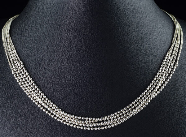 925 Sterling Silver Beautiful Layer Necklace For Womens And Girls Model SYC 2N74. This is ideal for womens and girls. Unique piece comes on contemporay style perfect for all outfits. Suitable for daily use,office use and perfect gift for our loved ones. Importance of 925 Sterling Silver : We are aware of the trending style and beauty of Sterling silver but the Most Important Part of Sterling Silver 925 is the health benefits. Silver ions in Silver material has a proven record of antibiotic nature. The excellent way to obtain health improvement from 925 Sterling silver is whenit get in touch with the skin. Silver is antibacterial too and helps to improve blood circulation and help remove toxins present in the human body. Some studies even mention about the defensivepower of Silver JewelryagainstHazardous electromagnetic radiations emittingfrom Mobile phones or Laptops. Electrical and Thermal conductivity of Sterling silver 925 is the highlighted quality which indicate the capacity of Sterling silver to distribute electrical power as well as heat across the body.This is why Sterling silver boost the blood circulation, typical healing property and maintain the heat balance. If illnesses arrives , temperature level increases or hormonal change occurs Sterling silver wearing get appear more darker in color. Original 925 Sterling silver are more than 99% non allergic and skin friendly in nature. But Cheap Silver Plated Jewelryavailable in popular online sites ( in some websites they even wrongly mentioned it as sterling silver ) are dangerous for Skin especially those who have sensitive skin. We recommendto use Genuine quality Sterling Silver to avail health benefits and to avoid cheap fancy Silver Products. Pure Silver and 92.5 Sterling Silver : 100% Pure Silver also known as Fine Silver is heavily soft in nature , very malleable and most likely it will get damaged within a short time. It's not Practically Possible to make JewelryProducts in 100 Percentage Pure silver du