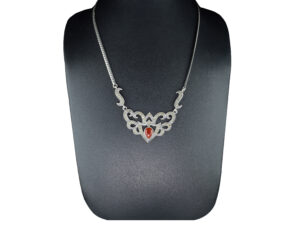 925 Sterling Oxidised Silver chain Crown Necklace With Marcasite Stone And Red Carnelian Stone Model SYC 1N039. This is ideal for womens and girls. Unique piece comes on contemporary style perfect for all outfits. Suitable for birthday functions, wedding ceremony, valentine gifts,engagements and perfect gift for our loved ones. This stylish necklace makes you feel more beautiful and elegant look. Importance of 925 Sterling Silver : We are aware of the trending style and beauty of Sterling silver but the Most Important Part of Sterling Silver 925 is the health benefits. Silver ions in Silver material has a proven record of antibiotic nature. The excellent way to obtain health improvement from 925 Sterling silver is whenit get in touch with the skin. Silver is antibacterial too and helps to improve blood circulation and help remove toxins present in the human body. Some studies even mention about the defensivepower of Silver JewelryagainstHazardous electromagnetic radiations emittingfrom Mobile phones or Laptops. Electrical and Thermal conductivity of Sterling silver 925 is the highlighted quality which indicate the capacity of Sterling silver to distribute electrical power as well as heat across the body.This is why Sterling silver boost the blood circulation, typical healing property and maintain the heat balance. If illnesses arrives , temperature level increases or hormonal change occurs Sterling silver wearing get appear more darker in color. Original 925 Sterling silver are more than 99% non allergic and skin friendly in nature. But Cheap Silver Plated Jewelryavailable in popular online sites ( in some websites they even wrongly mentioned it as sterling silver ) are dangerous for Skin especially those who have sensitive skin. We recommendto use Genuine quality Sterling Silver to avail health benefits and to avoid cheap fancy Silver Products. Pure Silver and 92.5 Sterling Silver : 100% Pure Silver also known as Fine Silver is heavily soft in nature , very malleab