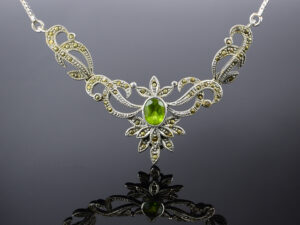 "925 Sterling Silver Chain Necklace With Marcasite Stone And Green Demantoid Garnet Stone Model SYC 1N029. This is ideal  for womens and girls. Unique piece comes on contemporary style perfect for all outfits.  Suitable for birthday functions, wedding ceremony, valentine gifts,engagements and perfect gift for our loved ones. This stylish necklace makes you feel more beautiful and elegant look. Importance of 925 Sterling Silver : We are aware of the trending style and beauty of Sterling silver but the Most Important Part of Sterling Silver 925 is the health benefits. Silver ions in Silver material has a proven record of antibiotic nature. The excellent way to obtain health improvement from 925 Sterling silver is when it get in touch with the skin. Silver is antibacterial too and helps to improve blood circulation and help remove toxins present in the human body. Some studies even mention about the defensive power of Silver Jewelry against Hazardous electro magnetic radiations emitting from Mobile phones or Laptops. Electrical and Thermal conductivity of Sterling silver 925 is the highlighted quality which indicate the capacity of Sterling silver to distribute electrical power as well as heat across the body.This is why Sterling silver boost the blood circulation, typical healing property and maintain the heat balance. If illnesses arrives , temperature level increases or hormonal change occurs Sterling silver wearing get appear more darker in color. Original 925 Sterling silver are more than 99% non allergic and skin friendly in nature. But Cheap Silver Plated Jewelry available in popular online sites ( in some websites they even wrongly mentioned it as sterling silver ) are dangerous for Skin especially those who have sensitive skin. We recommend to use Genuine quality Sterling Silver to avail health benefits and to avoid cheap fancy Silver Products.  Pure Silver and 92.5 Sterling Silver : 100% Pure Silver also known as Fine Silver is heavily soft in nature , very malleable and most likely it will get damaged within a short time. It's not Practically Possible to make Jewelry Products in 100 Percentage Pure silver due because Jewels will bend and have to be straightened. To tackle this and same time to remain the highest Silver Material Quality, 925 Sterling Silver is introduced. Sterling Silver contains 92.5 % Pure silver and alloys on other 7.5 % usually Copper. This helps sterling silver to increase hardness, durability, strength and reduce tarnishing. Silver designers can made Outstanding Trending Silverware collection with sterling silver 925 due to the mentioned properties. 925 Sterling silver Jewellery gives more beauty and elegant look. Sterling silver even suits for black skin tones. Sterling silver enhances beauty and give a pretty modern look. ""Sterling silver 925"" word is associated with superior quality since ancient times. Silverycraft Luxury Sterling silver Jewel's are affordable too.  Caring the Valuable Silver Jewels : Silverycraft Products especially Sterling Silver 925 need less care compared to other brands. Still it's important to do proper care mainly Keep your precious Silver away from high humidity, Chemicals, Oils, Perfumes, Hair products, water containing Chlorine etc which may cause tarnish in silver. Precious Stones used in Silver Jewels need Special care. Flannel Treated Bags & cloth helps to retard tarnishing in Silver while Long Storage or you can use a Cloth pouch or Separate box for Storage at Home. You can Clean Sterling silver using very soft Banyan cloth. After the tarnish disappears ,rinse your Silver jewellery with water and dry it using a soft cloth. Its is easy to care and usually no maintenance issue occurs. Usual Tarnishing or Silver Color Variation (oxidation) due to interaction with atmosphere is common and it also indicate the symbol of Original silver content in the jewellery. Regular Caring will definitely reduce tarnishing to a great extend.SILVERYCRAFT original Silver craft jewellery in India and genuine sterling silver 92.5 jewelry collection silver products silver gifts silver wedding collections female male kids silver sterling 925 silver jewels rare collection silvers Fashion silver fashonable silver crafts Indian made silver e commerce website online silver purchase buy silver jewelleries online SILVERYCRAFT Silver jewellery's Silvery crafts crafted silvers India's fine quality silver at www.silverycraft.com"