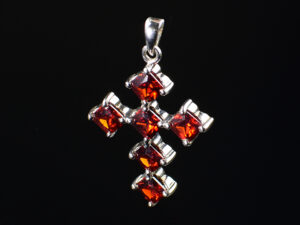 "925 Sterling Silver Locket Holy Cross With Semi Precious Red Pyrope Garnet Pendant Model SYC 1LS079. This is ideal  for womens and girls. Unique piece comes on contemporary style perfect for all outfits. Suitable for birthday functions, wedding ceremony, valentine gifts,engagements and perfect gift for our loved ones. Importance of 925 Sterling Silver : We are aware of the trending style and beauty of Sterling silver but the Most Important Part of Sterling Silver 925 is the health benefits. Silver ions in Silver material has a proven record of antibiotic nature. The excellent way to obtain health improvement from 925 Sterling silver is when it get in touch with the skin. Silver is antibacterial too and helps to improve blood circulation and help remove toxins present in the human body. Some studies even mention about the defensive power of Silver Jewelry against Hazardous electro magnetic radiations emitting from Mobile phones or Laptops. Electrical and Thermal conductivity of Sterling silver 925 is the highlighted quality which indicate the capacity of Sterling silver to distribute electrical power as well as heat across the body.This is why Sterling silver boost the blood circulation, typical healing property and maintain the heat balance. If illnesses arrives , temperature level increases or hormonal change occurs Sterling silver wearing get appear more darker in color. Original 925 Sterling silver are more than 99% non allergic and skin friendly in nature. But Cheap Silver Plated Jewelry available in popular online sites ( in some websites they even wrongly mentioned it as sterling silver ) are dangerous for Skin especially those who have sensitive skin. We recommend to use Genuine quality Sterling Silver to avail health benefits and to avoid cheap fancy Silver Products.  Pure Silver and 92.5 Sterling Silver : 100% Pure Silver also known as Fine Silver is heavily soft in nature , very malleable and most likely it will get damaged within a short time. It's not Practically Possible to make Jewelry Products in 100 Percentage Pure silver due because Jewels will bend and have to be straightened. To tackle this and same time to remain the highest Silver Material Quality, 925 Sterling Silver is introduced. Sterling Silver contains 92.5 % Pure silver and alloys on other 7.5 % usually Copper. This helps sterling silver to increase hardness, durability, strength and reduce tarnishing. Silver designers can made Outstanding Trending Silverware collection with sterling silver 925 due to the mentioned properties. 925 Sterling silver Jewellery gives more beauty and elegant look. Sterling silver even suits for black skin tones. Sterling silver enhances beauty and give a pretty modern look. ""Sterling silver 925"" word is associated with superior quality since ancient times. Silverycraft Luxury Sterling silver Jewel's are affordable too.  Caring the Valuable Silver Jewels : Silverycraft Products especially Sterling Silver 925 need less care compared to other brands. Still it's important to do proper care mainly Keep your precious Silver away from high humidity, Chemicals, Oils, Perfumes, Hair products, water containing Chlorine etc which may cause tarnish in silver. Precious Stones used in Silver Jewels need Special care. Flannel Treated Bags & cloth helps to retard tarnishing in Silver while Long Storage or you can use a Cloth pouch or Separate box for Storage at Home. You can Clean Sterling silver using very soft Banyan cloth. After the tarnish disappears ,rinse your Silver jewellery with water and dry it using a soft cloth. Its is easy to care and usually no maintenance issue occurs. Usual Tarnishing or Silver Color Variation (oxidation) due to interaction with atmosphere is common and it also indicate the symbol of Original silver content in the jewellery. Regular Caring will definitely reduce tarnishing to a great extend.SILVERYCRAFT original Silver craft jewellery in India and genuine sterling silver 92.5 jewelry collection silver products silver gifts silver wedding collections female male kids silver sterling 925 silver jewels rare collection silvers Fashion silver fashonable silver crafts Indian made silver e commerce website online silver purchase buy silver jewelleries online SILVERYCRAFT Silver jewellery's Silvery crafts crafted silvers India's fine quality silver at www.silverycraft.com"