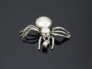 "925 Sterling Silver Locket Spider Pendant Model SYC 2L54.This is ideal  for males and females. Unique piece comes on contemporary style perfect for all outfits. Suitable for daily use,office use and perfect gift for our loved ones.  Importance of 925 Sterling Silver : We are aware of the trending style and beauty of Sterling silver but the Most Important Part of Sterling Silver 925 is the health benefits. Silver ions in Silver material has a proven record of antibiotic nature. The excellent way to obtain health improvement from 925 Sterling silver is when it get in touch with the skin. Silver is antibacterial too and helps to improve blood circulation and help remove toxins present in the human body. Some studies even mention about the defensive power of Silver Jewelry against Hazardous electro magnetic radiations emitting from Mobile phones or Laptops. Electrical and Thermal conductivity of Sterling silver 925 is the highlighted quality which indicate the capacity of Sterling silver to distribute electrical power as well as heat across the body.This is why Sterling silver boost the blood circulation, typical healing property and maintain the heat balance. If illnesses arrives , temperature level increases or hormonal change occurs Sterling silver wearing get appear more darker in color. Original 925 Sterling silver are more than 99% non allergic and skin friendly in nature. But Cheap Silver Plated Jewelry available in popular online sites ( in some websites they even wrongly mentioned it as sterling silver ) are dangerous for Skin especially those who have sensitive skin. We recommend to use Genuine quality Sterling Silver to avail health benefits and to avoid cheap fancy Silver Products.  Pure Silver and 92.5 Sterling Silver : 100% Pure Silver also known as Fine Silver is heavily soft in nature , very malleable and most likely it will get damaged within a short time. It's not Practically Possible to make Jewelry Products in 100 Percentage Pure silver due because Jewels will bend and have to be straightened. To tackle this and same time to remain the highest Silver Material Quality, 925 Sterling Silver is introduced. Sterling Silver contains 92.5 % Pure silver and alloys on other 7.5 % usually Copper. This helps sterling silver to increase hardness, durability, strength and reduce tarnishing. Silver designers can made Outstanding Trending Silverware collection with sterling silver 925 due to the mentioned properties. 925 Sterling silver Jewellery gives more beauty and elegant look. Sterling silver even suits for black skin tones. Sterling silver enhances beauty and give a pretty modern look. ""Sterling silver 925"" word is associated with superior quality since ancient times. Silverycraft Luxury Sterling silver Jewel's are affordable too.  Caring the Valuable Silver Jewels : Silverycraft Products especially Sterling Silver 925 need less care compared to other brands. Still it's important to do proper care mainly Keep your precious Silver away from high humidity, Chemicals, Oils, Perfumes, Hair products, water containing Chlorine etc which may cause tarnish in silver. Precious Stones used in Silver Jewels need Special care. Flannel Treated Bags & cloth helps to retard tarnishing in Silver while Long Storage or you can use a Cloth pouch or Separate box for Storage at Home. You can Clean Sterling silver using very soft Banyan cloth. After the tarnish disappears ,rinse your Silver jewellery with water and dry it using a soft cloth. Its is easy to care and usually no maintenance issue occurs. Usual Tarnishing or Silver Color Variation (oxidation) due to interaction with atmosphere is common and it also indicate the symbol of Original silver content in the jewellery. Regular Caring will definitely reduce tarnishing to a great extend.SILVERYCRAFT original Silver craft jewellery in India and genuine sterling silver 92.5 jewelry collection silver products silver gifts silver wedding collections female male kids silver sterling 925 silver jewels rare collection silvers Fashion silver fashonable silver crafts Indian made silver e commerce website online silver purchase buy silver jewelleries online SILVERYCRAFT Silver jewellery's Silvery crafts crafted silvers India's fine quality silver at www.silverycraft.com"