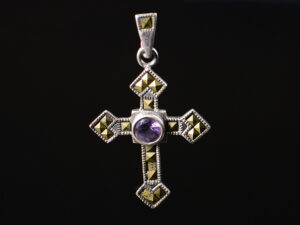 925 Sterling Silver Locket Holy Cross With Marcasite And Purple Stones Pendant Model SYC 1LS102. This is ideal for womens and girls. Unique piece comes on contemporary style perfect for all outfits. Suitable for birthday functions, wedding ceremony, valentine gifts,engagements and perfect gift for our loved ones. Importance of 925 Sterling Silver : We are aware of the trending style and beauty of Sterling silver but the Most Important Part of Sterling Silver 925 is the health benefits. Silver ions in Silver material has a proven record of antibiotic nature. The excellent way to obtain health improvement from 925 Sterling silver is whenit get in touch with the skin. Silver is antibacterial too and helps to improve blood circulation and help remove toxins present in the human body. Some studies even mention about the defensivepower of Silver JewelryagainstHazardous electromagnetic radiations emittingfrom Mobile phones or Laptops. Electrical and Thermal conductivity of Sterling silver 925 is the highlighted quality which indicate the capacity of Sterling silver to distribute electrical power as well as heat across the body.This is why Sterling silver boost the blood circulation, typical healing property and maintain the heat balance. If illnesses arrives , temperature level increases or hormonal change occurs Sterling silver wearing get appear more darker in color. Original 925 Sterling silver are more than 99% non allergic and skin friendly in nature. But Cheap Silver Plated Jewelryavailable in popular online sites ( in some websites they even wrongly mentioned it as sterling silver ) are dangerous for Skin especially those who have sensitive skin. We recommendto use Genuine quality Sterling Silver to avail health benefits and to avoid cheap fancy Silver Products. Pure Silver and 92.5 Sterling Silver : 100% Pure Silver also known as Fine Silver is heavily soft in nature , very malleable and most likely it will get damaged within a short time. It's not Practically Poss