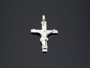 "925 Sterling Silver locket holy divine Jesus Christ pendant model SYC 2L6. It symbolize Jesus Christ. Crosses are often worn as an indication of commitment to the christian faith. Ideal for both females and males.Suitable for daily use, office use, casual wear and any other occasions. Importance of 925 Sterling Silver : We are aware of the trending style and beauty of Sterling silver but the Most Important Part of Sterling Silver 925 is the health benefits. Silver ions in Silver material has a proven record of antibiotic nature. The excellent way to obtain health improvement from 925 Sterling silver is when it get in touch with the skin. Silver is antibacterial too and helps to improve blood circulation and help remove toxins present in the human body. Some studies even mention about the defensive power of Silver Jewelry against Hazardous electro magnetic radiations emitting from Mobile phones or Laptops. Electrical and Thermal conductivity of Sterling silver 925 is the highlighted quality which indicate the capacity of Sterling silver to distribute electrical power as well as heat across the body.This is why Sterling silver boost the blood circulation, typical healing property and maintain the heat balance. If illnesses arrives , temperature level increases or hormonal change occurs Sterling silver wearing get appear more darker in color. Original 925 Sterling silver are more than 99% non allergic and skin friendly in nature. But Cheap Silver Plated Jewelry available in popular online sites ( in some websites they even wrongly mentioned it as sterling silver ) are dangerous for Skin especially those who have sensitive skin. We recommend to use Genuine quality Sterling Silver to avail health benefits and to avoid cheap fancy Silver Products.  Pure Silver and 92.5 Sterling Silver : 100% Pure Silver also known as Fine Silver is heavily soft in nature , very malleable and most likely it will get damaged within a short time. It's not Practically Possible to make Jewelry Products in 100 Percentage Pure silver due because Jewels will bend and have to be straightened. To tackle this and same time to remain the highest Silver Material Quality, 925 Sterling Silver is introduced. Sterling Silver contains 92.5 % Pure silver and alloys on other 7.5 % usually Copper. This helps sterling silver to increase hardness, durability, strength and reduce tarnishing. Silver designers can made Outstanding Trending Silverware collection with sterling silver 925 due to the mentioned properties. 925 Sterling silver Jewellery gives more beauty and elegant look. Sterling silver even suits for black skin tones. Sterling silver enhances beauty and give a pretty modern look. ""Sterling silver 925"" word is associated with superior quality since ancient times. Silverycraft Luxury Sterling silver Jewel's are affordable too.  Caring the Valuable Silver Jewels : Silverycraft Products especially Sterling Silver 925 need less care compared to other brands. Still it's important to do proper care mainly Keep your precious Silver away from high humidity, Chemicals, Oils, Perfumes, Hair products, water containing Chlorine etc which may cause tarnish in silver. Precious Stones used in Silver Jewels need Special care. Flannel Treated Bags & cloth helps to retard tarnishing in Silver while Long Storage or you can use a Cloth pouch or Separate box for Storage at Home. You can Clean Sterling silver using very soft Banyan cloth. After the tarnish disappears ,rinse your Silver jewellery with water and dry it using a soft cloth. Its is easy to care and usually no maintenance issue occurs. Usual Tarnishing or Silver Color Variation (oxidation) due to interaction with atmosphere is common and it also indicate the symbol of Original silver content in the jewellery. Regular Caring will definitely reduce tarnishing to a great extend.SILVERYCRAFT original Silver craft jewellery in India and genuine sterling silver 92.5 jewelry collection silver products silver gifts silver wedding collections female male kids silver sterling 925 silver jewels rare collection silvers Fashion silver fashonable silver crafts Indian made silver e commerce website online silver purchase buy silver jewelleries online SILVERYCRAFT Silver jewellery's Silvery crafts crafted silvers India's fine quality silver at www.silverycraft.com"