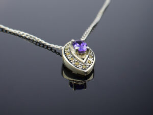 925 Sterling Silver Chain With Marcasite Stone And Violet Sapphire Stone Pendant Model SYC 1CHF034. This is ideal for womens and girls. Unique piece comes on contemporary style perfect for all outfits. Suitable for birthday functions, wedding ceremony, valentine gifts,engagements and perfect gift for our loved ones. Importance of 925 Sterling Silver : We are aware of the trending style and beauty of Sterling silver but the Most Important Part of Sterling Silver 925 is the health benefits. Silver ions in Silver material has a proven record of antibiotic nature. The excellent way to obtain health improvement from 925 Sterling silver is whenit get in touch with the skin. Silver is antibacterial too and helps to improve blood circulation and help remove toxins present in the human body. Some studies even mention about the defensivepower of Silver JewelryagainstHazardous electromagnetic radiations emittingfrom Mobile phones or Laptops. Electrical and Thermal conductivity of Sterling silver 925 is the highlighted quality which indicate the capacity of Sterling silver to distribute electrical power as well as heat across the body.This is why Sterling silver boost the blood circulation, typical healing property and maintain the heat balance. If illnesses arrives , temperature level increases or hormonal change occurs Sterling silver wearing get appear more darker in color. Original 925 Sterling silver are more than 99% non allergic and skin friendly in nature. But Cheap Silver Plated Jewelryavailable in popular online sites ( in some websites they even wrongly mentioned it as sterling silver ) are dangerous for Skin especially those who have sensitive skin. We recommendto use Genuine quality Sterling Silver to avail health benefits and to avoid cheap fancy Silver Products. Pure Silver and 92.5 Sterling Silver : 100% Pure Silver also known as Fine Silver is heavily soft in nature , very malleable and most likely it will get damaged within a short time. It's not Practically P