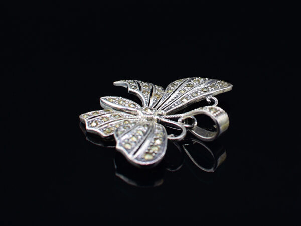 "925 Sterling Silver Locket Butterfly With Mercasite Stones Pendant Model SYC 1LS009. This is ideal  for womens and girls. Unique piece comes on contemporary style perfect for all outfits. Suitable for birthday functions, wedding ceremony, valentine gifts,engagements and perfect gift for our loved ones. Importance of 925 Sterling Silver : We are aware of the trending style and beauty of Sterling silver but the Most Important Part of Sterling Silver 925 is the health benefits. Silver ions in Silver material has a proven record of antibiotic nature. The excellent way to obtain health improvement from 925 Sterling silver is when it get in touch with the skin. Silver is antibacterial too and helps to improve blood circulation and help remove toxins present in the human body. Some studies even mention about the defensive power of Silver Jewelry against Hazardous electro magnetic radiations emitting from Mobile phones or Laptops. Electrical and Thermal conductivity of Sterling silver 925 is the highlighted quality which indicate the capacity of Sterling silver to distribute electrical power as well as heat across the body.This is why Sterling silver boost the blood circulation, typical healing property and maintain the heat balance. If illnesses arrives , temperature level increases or hormonal change occurs Sterling silver wearing get appear more darker in color. Original 925 Sterling silver are more than 99% non allergic and skin friendly in nature. But Cheap Silver Plated Jewelry available in popular online sites ( in some websites they even wrongly mentioned it as sterling silver ) are dangerous for Skin especially those who have sensitive skin. We recommend to use Genuine quality Sterling Silver to avail health benefits and to avoid cheap fancy Silver Products.  Pure Silver and 92.5 Sterling Silver : 100% Pure Silver also known as Fine Silver is heavily soft in nature , very malleable and most likely it will get damaged within a short time. It's not Practically Possible to make Jewelry Products in 100 Percentage Pure silver due because Jewels will bend and have to be straightened. To tackle this and same time to remain the highest Silver Material Quality, 925 Sterling Silver is introduced. Sterling Silver contains 92.5 % Pure silver and alloys on other 7.5 % usually Copper. This helps sterling silver to increase hardness, durability, strength and reduce tarnishing. Silver designers can made Outstanding Trending Silverware collection with sterling silver 925 due to the mentioned properties. 925 Sterling silver Jewellery gives more beauty and elegant look. Sterling silver even suits for black skin tones. Sterling silver enhances beauty and give a pretty modern look. ""Sterling silver 925"" word is associated with superior quality since ancient times. Silverycraft Luxury Sterling silver Jewel's are affordable too.  Caring the Valuable Silver Jewels : Silverycraft Products especially Sterling Silver 925 need less care compared to other brands. Still it's important to do proper care mainly Keep your precious Silver away from high humidity, Chemicals, Oils, Perfumes, Hair products, water containing Chlorine etc which may cause tarnish in silver. Precious Stones used in Silver Jewels need Special care. Flannel Treated Bags & cloth helps to retard tarnishing in Silver while Long Storage or you can use a Cloth pouch or Separate box for Storage at Home. You can Clean Sterling silver using very soft Banyan cloth. After the tarnish disappears ,rinse your Silver jewellery with water and dry it using a soft cloth. Its is easy to care and usually no maintenance issue occurs. Usual Tarnishing or Silver Color Variation (oxidation) due to interaction with atmosphere is common and it also indicate the symbol of Original silver content in the jewellery. Regular Caring will definitely reduce tarnishing to a great extend.SILVERYCRAFT original Silver craft jewellery in India and genuine sterling silver 92.5 jewelry collection silver products silver gifts silver wedding collections female male kids silver sterling 925 silver jewels rare collection silvers Fashion silver fashonable silver crafts Indian made silver e commerce website online silver purchase buy silver jewelleries online SILVERYCRAFT Silver jewellery's Silvery crafts crafted silvers India's fine quality silver at www.silverycraft.com"