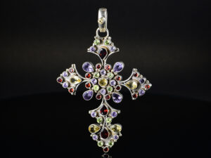 925 Sterling Silver Locket Holy Cross With Semi Precious Multi Colored Stones Pendant Model SYC 1LS090. This is ideal for womens and girls. Unique piece comes on contemporary style perfect for all outfits. Suitable for birthday functions, wedding ceremony, valentine gifts,engagements and perfect gift for our loved ones. Importance of 925 Sterling Silver : We are aware of the trending style and beauty of Sterling silver but the Most Important Part of Sterling Silver 925 is the health benefits. Silver ions in Silver material has a proven record of antibiotic nature. The excellent way to obtain health improvement from 925 Sterling silver is whenit get in touch with the skin. Silver is antibacterial too and helps to improve blood circulation and help remove toxins present in the human body. Some studies even mention about the defensivepower of Silver JewelryagainstHazardous electromagnetic radiations emittingfrom Mobile phones or Laptops. Electrical and Thermal conductivity of Sterling silver 925 is the highlighted quality which indicate the capacity of Sterling silver to distribute electrical power as well as heat across the body.This is why Sterling silver boost the blood circulation, typical healing property and maintain the heat balance. If illnesses arrives , temperature level increases or hormonal change occurs Sterling silver wearing get appear more darker in color. Original 925 Sterling silver are more than 99% non allergic and skin friendly in nature. But Cheap Silver Plated Jewelryavailable in popular online sites ( in some websites they even wrongly mentioned it as sterling silver ) are dangerous for Skin especially those who have sensitive skin. We recommendto use Genuine quality Sterling Silver to avail health benefits and to avoid cheap fancy Silver Products. Pure Silver and 92.5 Sterling Silver : 100% Pure Silver also known as Fine Silver is heavily soft in nature , very malleable and most likely it will get damaged within a short time. It's not Practical