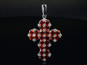"925 Sterling Silver Locket Holy Cross  with semi precious white stones and ruby pendant Model SYC 1LS003. This is ideal  for womens and girls. Unique piece comes on contemporary style perfect for all outfits. Suitable for birthday functions, wedding ceremony, valentine gifts,engagements and perfect gift for our loved ones. Importance of 925 Sterling Silver : We are aware of the trending style and beauty of Sterling silver but the Most Important Part of Sterling Silver 925 is the health benefits. Silver ions in Silver material has a proven record of antibiotic nature. The excellent way to obtain health improvement from 925 Sterling silver is when it get in touch with the skin. Silver is antibacterial too and helps to improve blood circulation and help remove toxins present in the human body. Some studies even mention about the defensive power of Silver Jewelry against Hazardous electro magnetic radiations emitting from Mobile phones or Laptops. Electrical and Thermal conductivity of Sterling silver 925 is the highlighted quality which indicate the capacity of Sterling silver to distribute electrical power as well as heat across the body.This is why Sterling silver boost the blood circulation, typical healing property and maintain the heat balance. If illnesses arrives , temperature level increases or hormonal change occurs Sterling silver wearing get appear more darker in color. Original 925 Sterling silver are more than 99% non allergic and skin friendly in nature. But Cheap Silver Plated Jewelry available in popular online sites ( in some websites they even wrongly mentioned it as sterling silver ) are dangerous for Skin especially those who have sensitive skin. We recommend to use Genuine quality Sterling Silver to avail health benefits and to avoid cheap fancy Silver Products.  Pure Silver and 92.5 Sterling Silver : 100% Pure Silver also known as Fine Silver is heavily soft in nature , very malleable and most likely it will get damaged within a short time. It's not Practically Possible to make Jewelry Products in 100 Percentage Pure silver due because Jewels will bend and have to be straightened. To tackle this and same time to remain the highest Silver Material Quality, 925 Sterling Silver is introduced. Sterling Silver contains 92.5 % Pure silver and alloys on other 7.5 % usually Copper. This helps sterling silver to increase hardness, durability, strength and reduce tarnishing. Silver designers can made Outstanding Trending Silverware collection with sterling silver 925 due to the mentioned properties. 925 Sterling silver Jewellery gives more beauty and elegant look. Sterling silver even suits for black skin tones. Sterling silver enhances beauty and give a pretty modern look. ""Sterling silver 925"" word is associated with superior quality since ancient times. Silverycraft Luxury Sterling silver Jewel's are affordable too.  Caring the Valuable Silver Jewels : Silverycraft Products especially Sterling Silver 925 need less care compared to other brands. Still it's important to do proper care mainly Keep your precious Silver away from high humidity, Chemicals, Oils, Perfumes, Hair products, water containing Chlorine etc which may cause tarnish in silver. Precious Stones used in Silver Jewels need Special care. Flannel Treated Bags & cloth helps to retard tarnishing in Silver while Long Storage or you can use a Cloth pouch or Separate box for Storage at Home. You can Clean Sterling silver using very soft Banyan cloth. After the tarnish disappears ,rinse your Silver jewellery with water and dry it using a soft cloth. Its is easy to care and usually no maintenance issue occurs. Usual Tarnishing or Silver Color Variation (oxidation) due to interaction with atmosphere is common and it also indicate the symbol of Original silver content in the jewellery. Regular Caring will definitely reduce tarnishing to a great extend.SILVERYCRAFT original Silver craft jewellery in India and genuine sterling silver 92.5 jewelry collection silver products silver gifts silver wedding collections female male kids silver sterling 925 silver jewels rare collection silvers Fashion silver fashonable silver crafts Indian made silver e commerce website online silver purchase buy silver jewelleries online SILVERYCRAFT Silver jewellery's Silvery crafts crafted silvers India's fine quality silver at www.silverycraft.com"