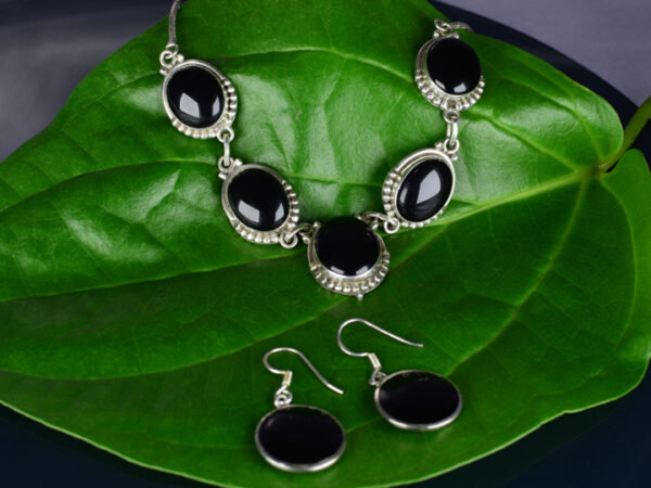 925 Sterling Silver Chain Necklace & Semi Precious Black Stone Pendant and semi precious Black Stone Earring Set Model SYC 2N24. This is ideal for womens and girls . Unique piece comes on contemporary style perfect for all outfits. Suitable for daily use,office use and perfect gift for our loved ones ,birthday functions, wedding ceremony, valentine gifts,engagements . Silver design beads makes more elegant and beautiful look. Importance of 925 Sterling Silver : We are aware of the trending style and beauty of Sterling silver but the Most Important Part of Sterling Silver 925 is the health benefits. Silver ions in Silver material has a proven record of antibiotic nature. The excellent way to obtain health improvement from 925 Sterling silver is when it get in touch with the skin. Silver is antibacterial too and helps to improve blood circulation and help remove toxins present in the human body. Some studies even mention about the defensive power of Silver Jewelry against Hazardous electro magnetic radiations emitting from Mobile phones or Laptops. Electrical and Thermal conductivity of Sterling silver 925 is the highlighted quality which indicate the capacity of Sterling silver to distribute electrical power as well as heat across the body.This is why Sterling silver boost the blood circulation, typical healing property and maintain the heat balance. If illnesses arrives , temperature level increases or hormonal change occurs Sterling silver wearing get appear more darker in color. Original 925 Sterling silver are more than 99% non allergic and skin friendly in nature. But Cheap Silver Plated Jewelry available in popular online sites ( in some websites they even wrongly mentioned it as sterling silver ) are dangerous for Skin especially those who have sensitive skin. We recommend to use Genuine quality Sterling Silver to avail health benefits and to avoid cheap fancy Silver Products. Pure Silver and 92.5 Sterling Silver : 100% Pure Silver also known as Fine Silver is
