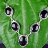 "925 Sterling Silver Chain Necklace & Semi Precious Black Stone Pendant and semi precious Black Stone Earring Set Model SYC 2N24. This is ideal for womens and girls . Unique piece comes on contemporary style perfect for all outfits. Suitable for daily use,office use and perfect gift for our loved ones ,birthday functions, wedding ceremony, valentine gifts,engagements . Silver design beads makes more elegant and beautiful look. Importance of 925 Sterling Silver : We are aware of the trending style and beauty of Sterling silver but the Most Important Part of Sterling Silver 925 is the health benefits. Silver ions in Silver material has a proven record of antibiotic nature. The excellent way to obtain health improvement from 925 Sterling silver is when it get in touch with the skin. Silver is antibacterial too and helps to improve blood circulation and help remove toxins present in the human body. Some studies even mention about the defensive power of Silver Jewelry against Hazardous electro magnetic radiations emitting from Mobile phones or Laptops. Electrical and Thermal conductivity of Sterling silver 925 is the highlighted quality which indicate the capacity of Sterling silver to distribute electrical power as well as heat across the body.This is why Sterling silver boost the blood circulation, typical healing property and maintain the heat balance. If illnesses arrives , temperature level increases or hormonal change occurs Sterling silver wearing get appear more darker in color. Original 925 Sterling silver are more than 99% non allergic and skin friendly in nature. But Cheap Silver Plated Jewelry available in popular online sites ( in some websites they even wrongly mentioned it as sterling silver ) are dangerous for Skin especially those who have sensitive skin. We recommend to use Genuine quality Sterling Silver to avail health benefits and to avoid cheap fancy Silver Products. Pure Silver and 92.5 Sterling Silver : 100% Pure Silver also known as Fine Silver is heavily soft in nature , very malleable and most likely it will get damaged within a short time. It's not Practically Possible to make Jewelry Products in 100 Percentage Pure silver due because Jewels will bend and have to be straightened. To tackle this and same time to remain the highest Silver Material Quality, 925 Sterling Silver is introduced. Sterling Silver contains 92.5 % Pure silver and alloys on other 7.5 % usually Copper. This helps sterling silver to increase hardness, durability, strength and reduce tarnishing. Silver designers can made Outstanding Trending Silverware collection with sterling silver 925 due to the mentioned properties. 925 Sterling silver Jewellery gives more beauty and elegant look. Sterling silver even suits for black skin tones. Sterling silver enhances beauty and give a pretty modern look. ""Sterling silver 925"" word is associated with superior quality since ancient times. Silverycraft Luxury Sterling silver Jewel's are affordable too. Caring the Valuable Silver Jewels : Silverycraft Products especially Sterling Silver 925 need less care compared to other brands. Still it's important to do proper care mainly Keep your precious Silver away from high humidity, Chemicals, Oils, Perfumes, Hair products, water containing Chlorine etc which may cause tarnish in silver. Precious Stones used in Silver Jewels need Special care. Flannel Treated Bags & cloth helps to retard tarnishing in Silver while Long Storage or you can use a Cloth pouch or Separate box for Storage at Home. You can Clean Sterling silver using very soft Banyan cloth. After the tarnish disappears ,rinse your Silver jewellery with water and dry it using a soft cloth. Its is easy to care and usually no maintenance issue occurs. Usual Tarnishing or Silver Color Variation (oxidation) due to interaction with atmosphere is common and it also indicate the symbol of Original silver content in the jewellery. Regular Caring will definitely reduce tarnishing to a great extend. SILVERYCRAFT original Silver craft jewellery in India and genuine sterling silver 92.5 jewelry collection silver products silver gifts silver wedding collections female male kids silver sterling 925 silver jewels rare collection silvers Fashion silver fashonable silver crafts Indian made silver e commerce website online silver purchase buy silver jewelleries online SILVERYCRAFT Silver jewellery's Silvery crafts crafted silvers India's fine quality silver at www.silverycraft.com"