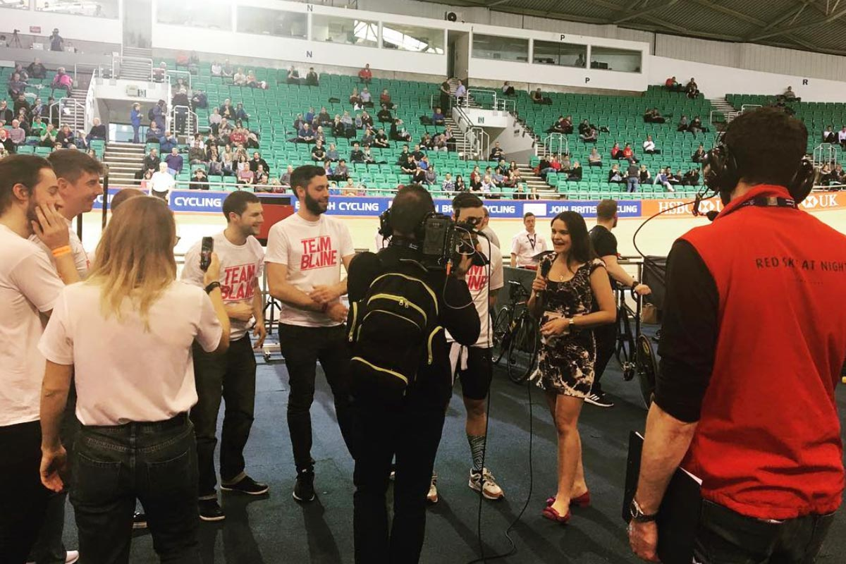 A photo of long-time RSAN collaborator Laura Winter conducting an interview at the 2018 British Cycling National Track Championships