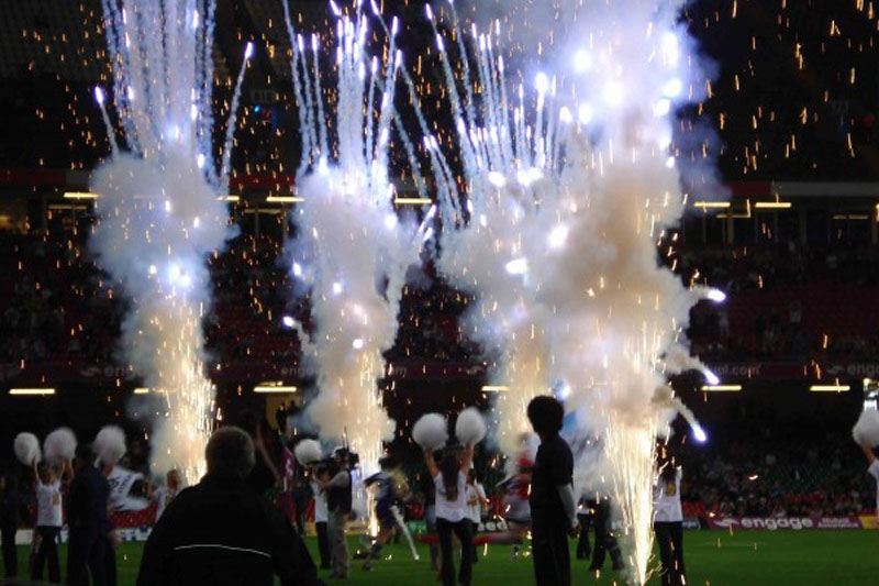A photo of fireworks and cheerleaders as the teams run out during the Rugby Football League Magic Weekend 2010