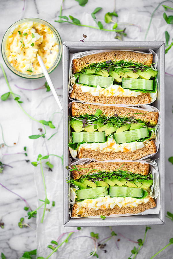avacado and egg salad sandwiches in tray