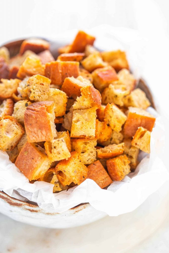 golden air fried croutons in a bowl