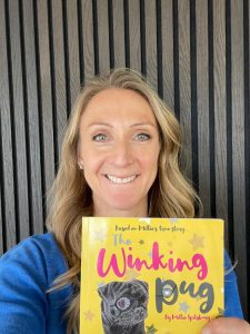 British Olympian Paula Radcliffe with The Winking Pug book