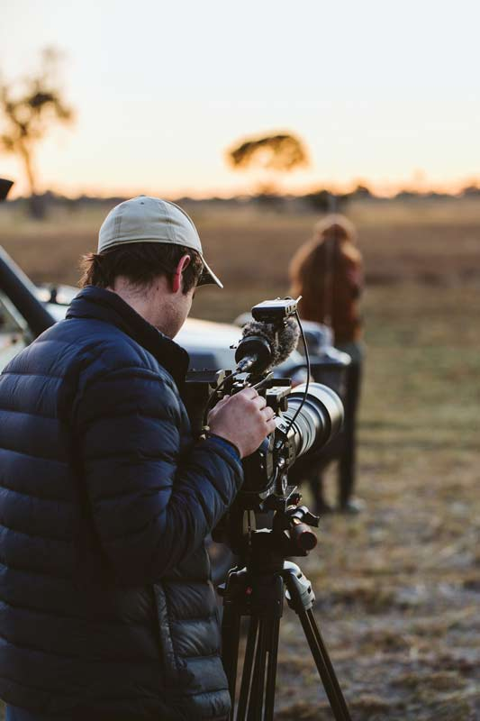 Director of photography, Oli Caldow looking through his camera lens while the Black Bean independent film production company is on assignment for Sanctuary Retreats in Baines Camp.