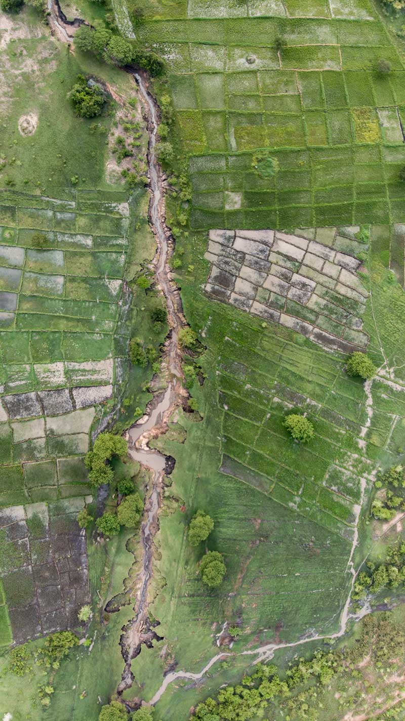 Drone shot of the corridor that separates wilderness areas and community areas in the Serengeti.