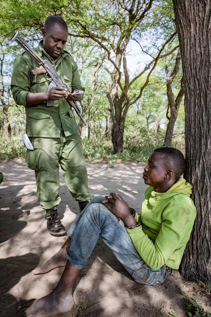 The Grumeti Fund Law Enforcement's Anti-Poaching Unit arrests a young man from a local