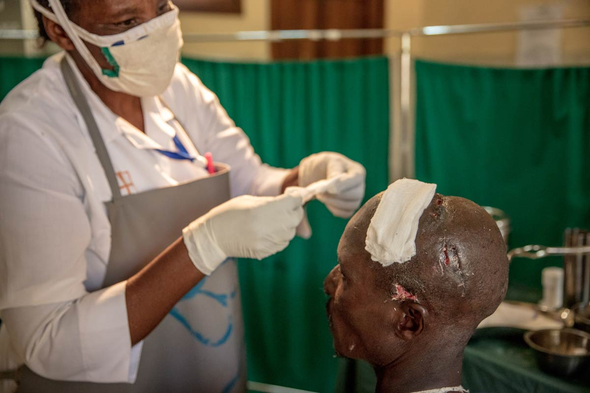 A man from the local community receives treatment at a local clinic for an injury caused by a human-wildlife conflict incident.