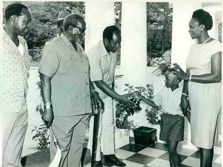 mzee_jomo_kenyatta_looks_at_his_son_muhoho_greets_a_guest_at_state_house_mombasa
