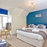 king size bedroom overlooking the harbour
